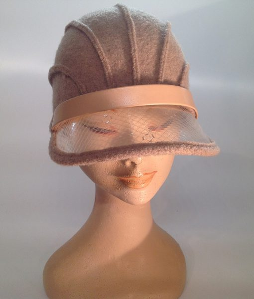 boiled wool cloche with plastic visor veil and leather applications – frontal view
