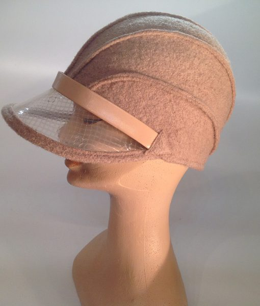 boiled wool cloche with plastic visor veil and leather applications - side view
