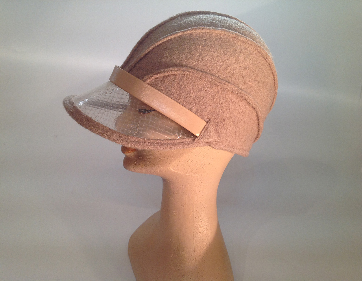 a7ff1d02a07 boiled wool cloche with plastic visor veil and leather applications - side  view